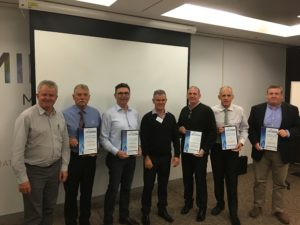NECWG-A/NZ Chair, Chris Beatson, and other members of NECWG-A/NZ being presented their award.